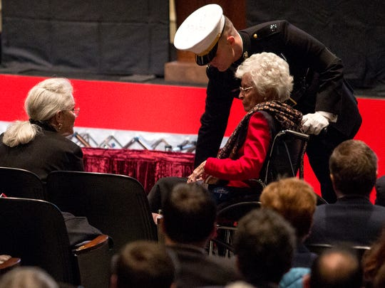 Annie Glenn is escorted to her seat by a U.S. Marine