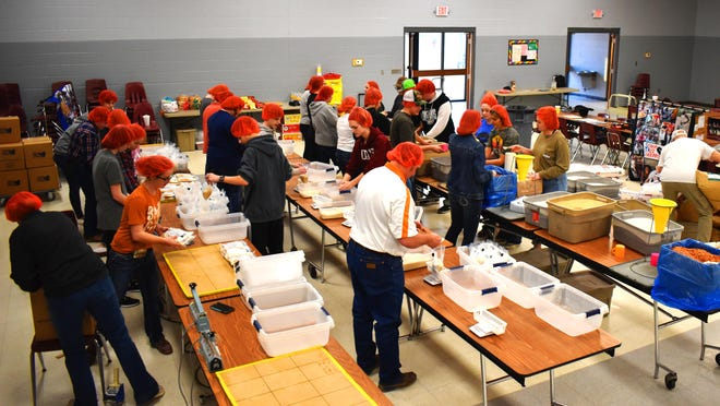 The Lone Grove cafeteria operating as an assembly line on Thursday evening. Lone Grove agriculture instructor Bethany Reiterman said FFA chapter officers organized a majority of the annual event.