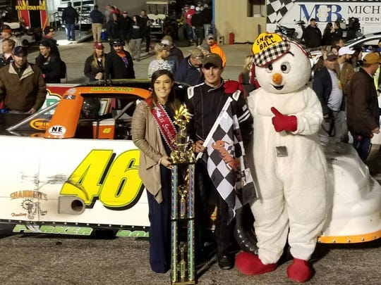 Molino resident Jarrett Parker with Miss Snowball Derby Raven Hammac, of Pensacola and Snowball mascot after Parker's dramatic win in the Snowball Pro-Trucks 50 Championship race Saturday night, the last before the two-day deluge of rain forced the Snowball Derby to Tuesday.