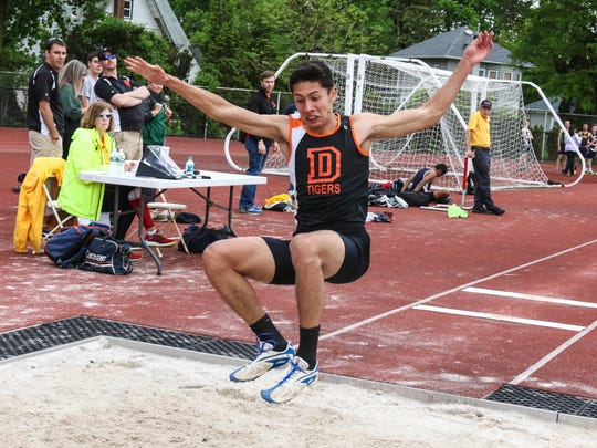 Dover senior Sebastian Cortes competes in the long jump during the Morris County Track and Field Championships at Boonton High School on May 17, 2018.