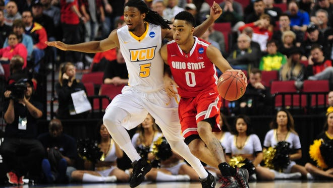 Ohio State's D'Angelo Russell dribbles against Virginia Commonwealth Rams guard Doug Brooks during the first half Thursday.