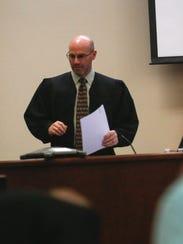 Judge Bradford J. Dalley presides over the murder trial