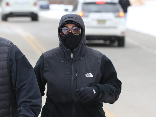 This woman is well protected from the cold as she wished to stay incognito while walking on a brisk afternoon along the road that runs through Garret Mountain Park.