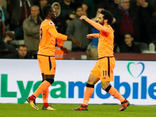 Liverpool's Mohamed Salah, right, celebrates scoring his sides first goal during the English Premier League soccer match between West Ham and Liverpool at the London Stadium in London, Saturday, Nov. 4, 2017. (AP Photo/Kirsty Wigglesworth)