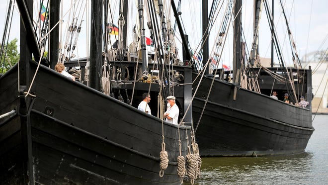 Visitors chat while they tour Niña, left, and sister ship Pinta at the Leicht Park docks Monday in Green Bay.