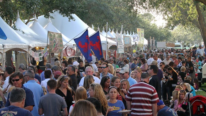 Crowds at the Jupiter Seafood Festival in 2013. This year's festival will be held Feb. 22 and 23 at Carlin Park.