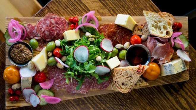 A charcuterie spread at The Parched Pig bar in Palm Beach Gardens.
