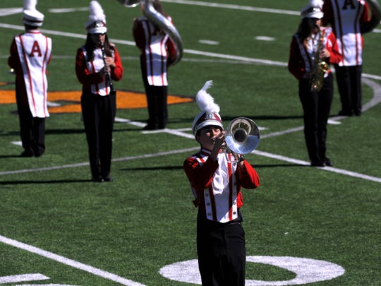 Soloist Max Balliew, plays the French horn for the Albany High School Ragin' Red Band Monday Oct. 23, 2017 at Wylie High School's Bulldog Stadium.