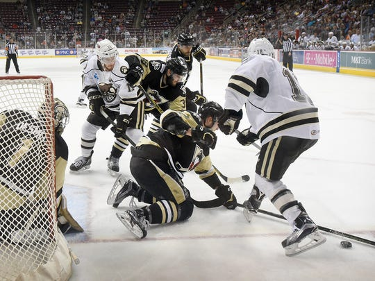 The Hershey Bears look to push the puck past the Wilkes-Barre/Scranton defense and goalie Casey DeSmith during a 4-0 loss in Game 1 of their Atlantic Division Finals series Wednesday at Giant Center.