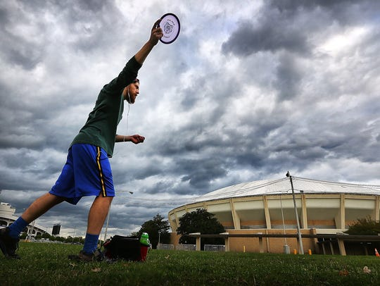 David Thiessen practices disc golf on the course near the Mid-South Coliseum.