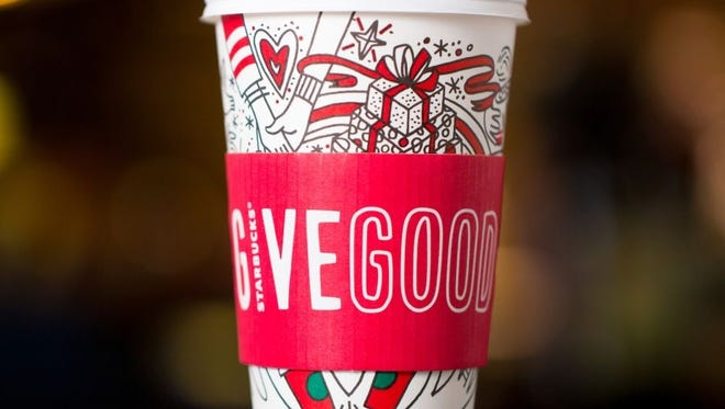 New holiday Starbucks cups allow patrons to color in the designs.