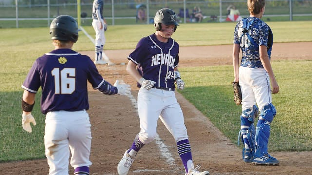 Nevada's Colin Memmer celebrates with teammate Cael Franzen (16) after crossing home plate during the Cubs' 11-1 victory over Colo-NESCO in five innings Thursday at the Nevada Cubs Baseball Field in Nevada. Photo by Nirmalendu Majumdar