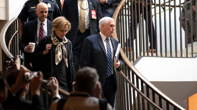 Vice President Mike Pence, center, joined at left by Dr. Deborah Birx, the coronavirus response coordinator, arrives at the Capitol to brief House members on the COVID-19 outbreak, in Washington on Wednesday. Congressional negotiators have reached agreement on an $8.3 billion bill to fund the government's response to the public health emergency.