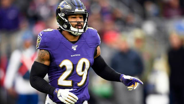 """In this Nov. 17, 2019, file photo, Baltimore Ravens free safety Earl Thomas waits for a play during the second half of the team's NFL football game against the Houston Texans in Baltimore. The lawyer for the wife of Baltimore Ravens safety Earl Thomas said she is being subjected to an """"unfounded ongoing investigation"""" by Texas police after she allegedly pointed a gun at her husband's head upon finding him in bed with another woman last month."""