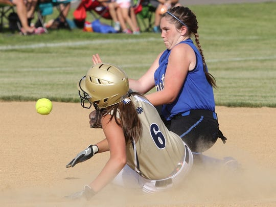 Mackenzie Mahajan of Notre Dame slides safely into second base as Sandy Creek shortstop Jasmyn Williams tries to field the throw during the Crusaders' 15-4 win Friday in a Class C state quarterfinal at Union-Endicott.