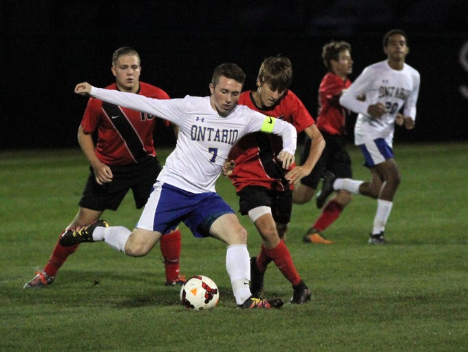 Ontario's Andrew Male takes control of the ball from