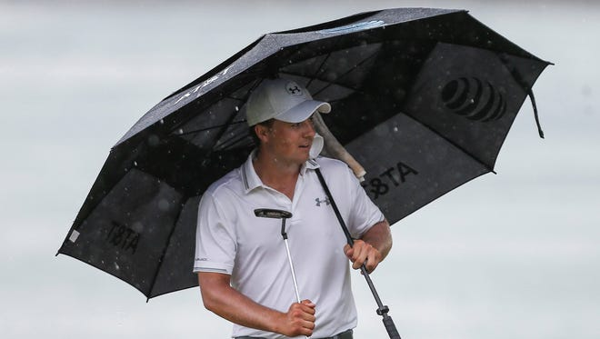 Current world No. 1 Jordan Spieth takes shelter from the rain during round two of the SMBC Singapore Open held at the Serapong Golf course.