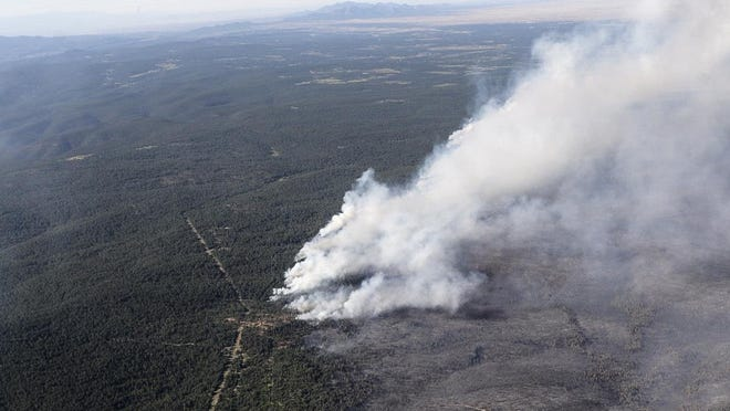 The Dog Head Fire, as seen from a Black Hawk helicopter Thursday, June 16, 2016, in Albuquerque, N.M.