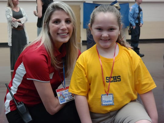 Vero Beach High School sssistant principal Rachel Serra poses with her second-grade pal, Shaelee.