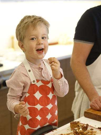 Arturo Chamberlin cooks in the kitchen with his dad,