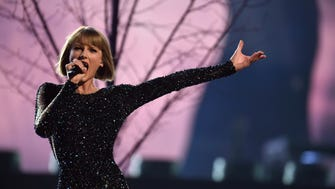 Taylor Swift performs during the 58th Grammy Awards at the Staples Center in Los Angeles.