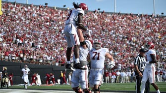 Alabama running back Bo Scarbrough (9) is lifted after scoring for a second time in the first half during the NCAA football game at Vanderbilt Stadium Saturday, Sept. 23, 2017 in Nashville, Tenn.