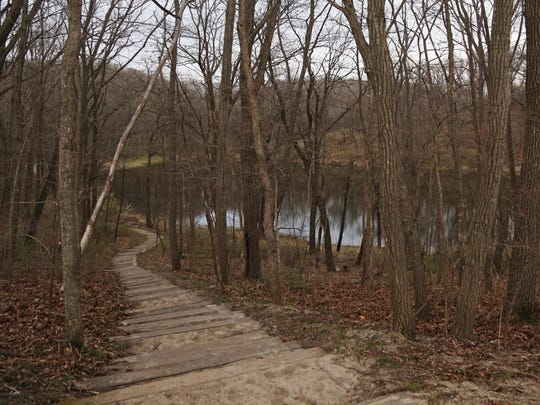 The lost lake trail bends around the lake at Ledges State Park on Tuesday, April 6, 2016, south of Boone.