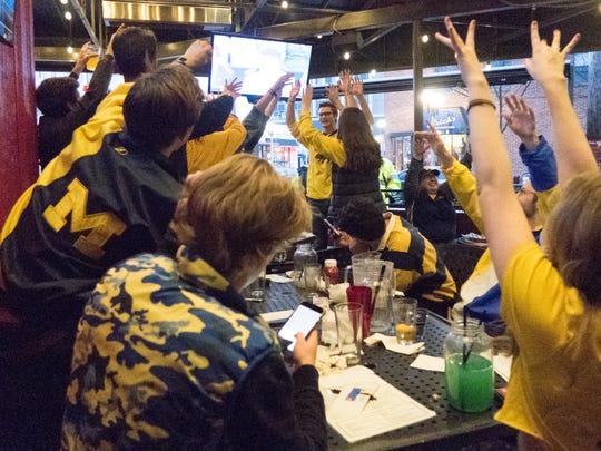 Fans celebrate the University of Michigan's 69-57 win