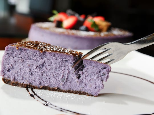 A taro cheesecake, topped with chocolate, fresh fruit