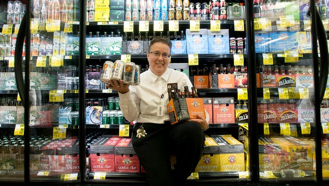 Lynn Ownbey, store manager, shows off the beer selection at Ingles store 7 on Tunnel Road on Thursday, Aug. 27, 2015. The store has a wide variety of local and craft beers for sale.