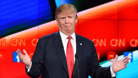 Donald Trump gestures during the Republican debate