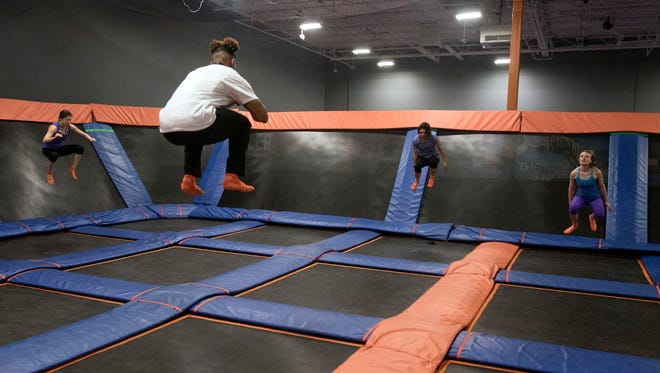 Trampoline exercise instructor Deshaun White teaches a class Saturday, January 27, 2018 during the Sky Fit class at Pensacola Sky Zone, an indoor trampoline park on North Davis Highway.