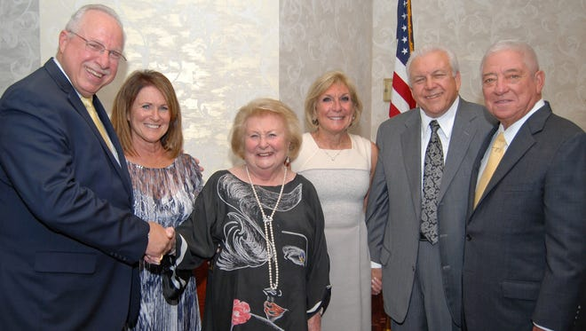 (From left) M. Jay Einstein, president of The Guidance Center; Sherry Kejzman Soutier; Helen Kejzman; Lilly Kejzman; Gus Fabietti, family friend and presenter; and Lawrence Pepper Jr., longtime Guidance Center board member and past president, at the 2016 Mental Health Distinguished Community Leaders Award dinner at Merighi's Savoy Inn. The center honored the Kejzman family.