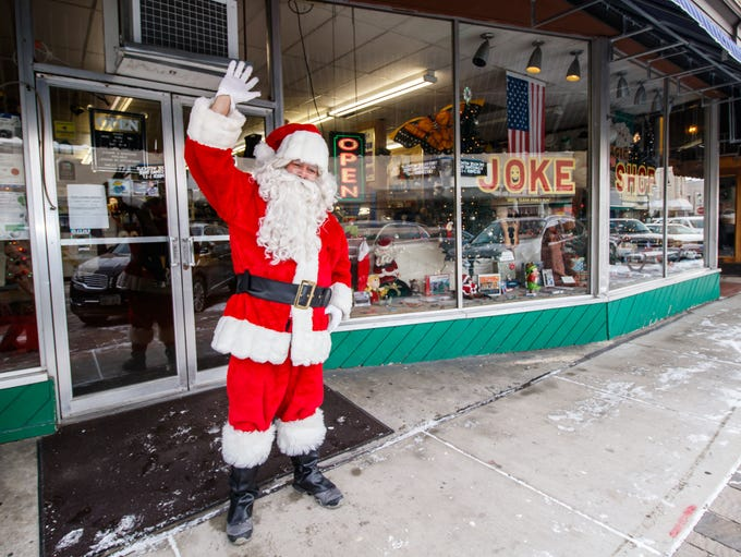 Santa greets visitors at the Joke Shop in Waukesha