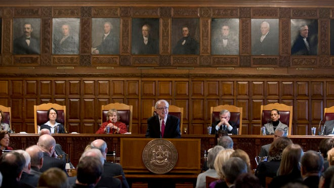 Chief Judge Jonathan Lippman delivers his State of the Judiciary address Tuesday at the Court of Appeals in Albany. Seated behind Lippman are Associate Judges Leslie Stein, Jenny Rivera, Susan Phillips Read, Eugene Pigott Jr., Sheila Abdus-Salaam and Eugene Fahey.