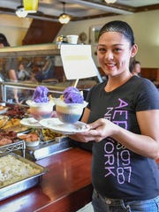 Server Leeann De Vera runs two servings of halo halo at Nayon Express in Harmon on Feb. 9.  Halo halo is traditionally a mixture of ice cream or shaved ice, topped with various sweets such as sweet beans, jellied candies, and other dessert items.