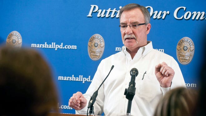 "In this Friday, Jan. 23, 2015 photo, Hank Hunt, father of Kari Hunt, speaks during a news conference about Kari's Law, at the Marshall Police Department in Marshall, Texas. Congress is close to finalizing changes to the nation's emergency dialing system inspired by a girl's struggle to call 911 as her mother lay dying from stab wounds in a Texas hotel room. ""Kari's Law"" was named after Kari Hunt Dunn, who was slain in 2013 when Brad Dunn, her estranged husband stormed into her hotel room and stabbed her multiple times while her children watched. (Michael Cavazos/The News-Journal via AP)"