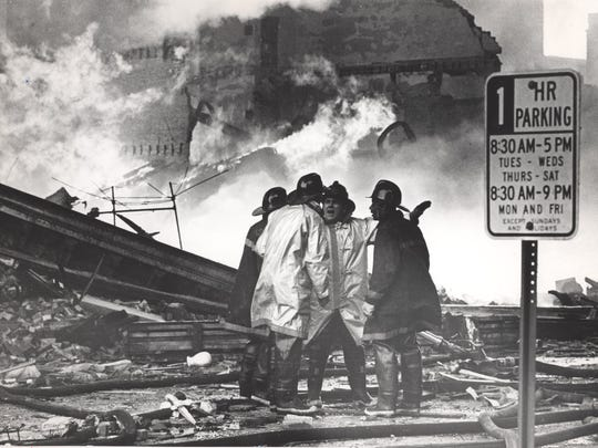 Firefighters discuss their plan of attack as a blaze