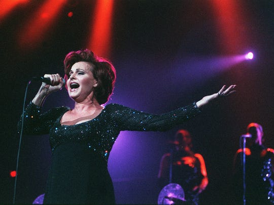 Rocío Dúrcal is seen on Oct. 2, 1999, during a concert in Phoenix at America West Arena (now Talking Stick Resort Arena).