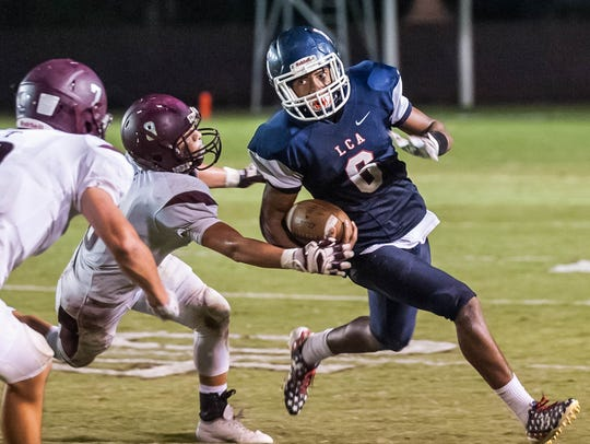 LCA's Errol Rogers had to play quarterback after the early-game injury to Zachary Clement. The Knights lost their first game of the season 10-9 to Vermilion Catholic.