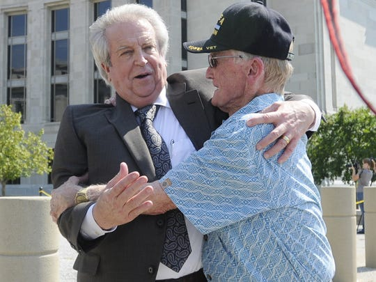 Milton McGregor is hugged by a supporter following the reading of the verdicts in the gambling corruption trial at the Federal Courthouse in Montgomery, Ala. on Thursday August 11, 2011. (Montgomery Advertiser, Mickey Welsh)