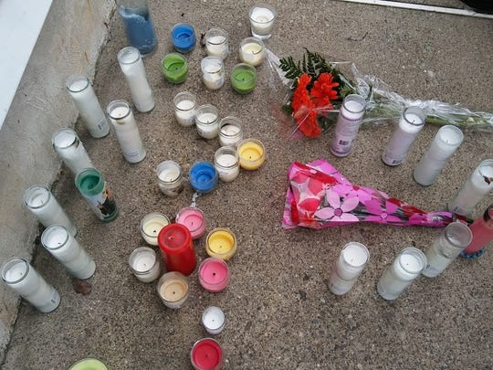 People have placed candles and flowers in front of Butler family home
