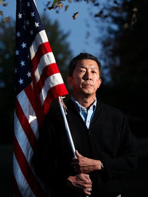Lee Wong of West Chester Township poses in his backyard.