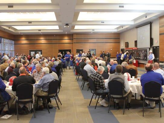 Fans and alumni gather in the Davison Athletics Complex