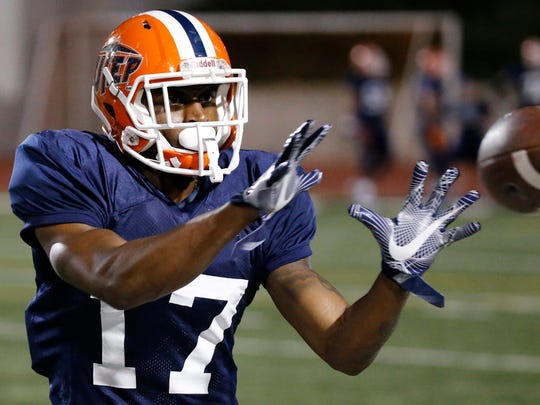 UTEP wide receiver Justin Garrett pulls in the football at the SAC Friday night as UTEP took their show on the road to the east side of El Paso Friday night and held a scrimmage in front of a small crowd.