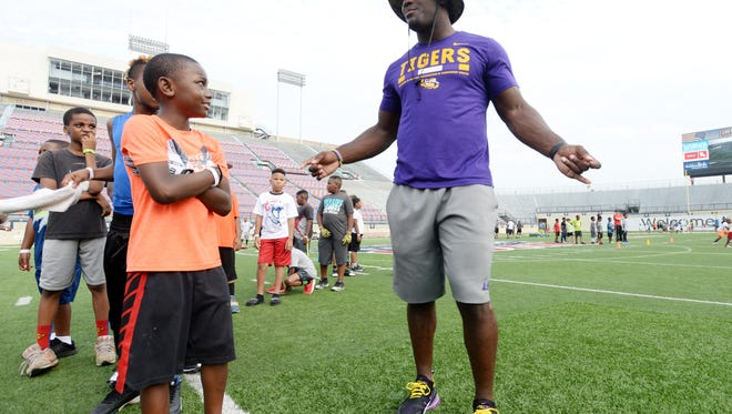 LSU standout and former North Webster linebacker Devin White was the counselor during the I-Bowl Youth Football Clinic Saturday morning at the Independence Stadium.