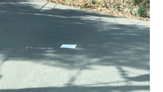 Readers have noticed these white rectangles appearing on local roadways, and they're curious as to what they're for and who's installing them.