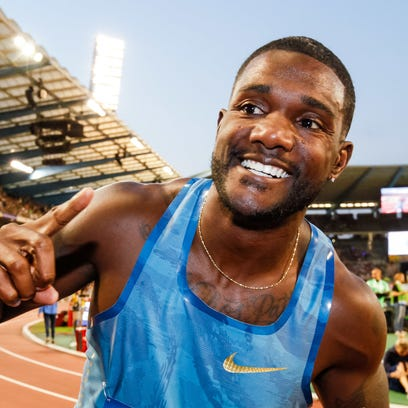 "Justin Gatlin, from the U.S., celebrates after winning the men's 100 meters at the Diamond League Memorial Van Damme athletics event at Brussels' King Baudouin stadium. Before a race, the mild-mannered American sprinter says he transforms himself into the feisty guy named ""J Gat,"" a nickname he's given to a version of himself that wants to take over the world from archrival Usain Bolt. (AP Photo/Francois Walschaerts, File)"