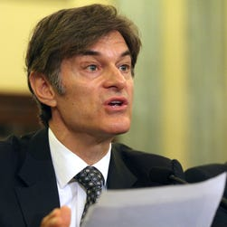 Mehmet Oz, vice chairman and professor of surgery, Columbia University College of Physicians and Surgeons, testifies on Capitol Hill in Washington in June, 2014.