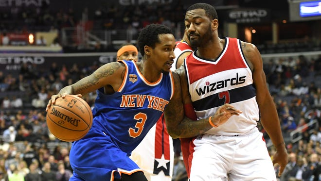 Guard Brandon Jennings might soon be finding himself on the same side as Wizards guard John Wall, right.